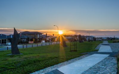 Sunrise over new home developments at Clyde North